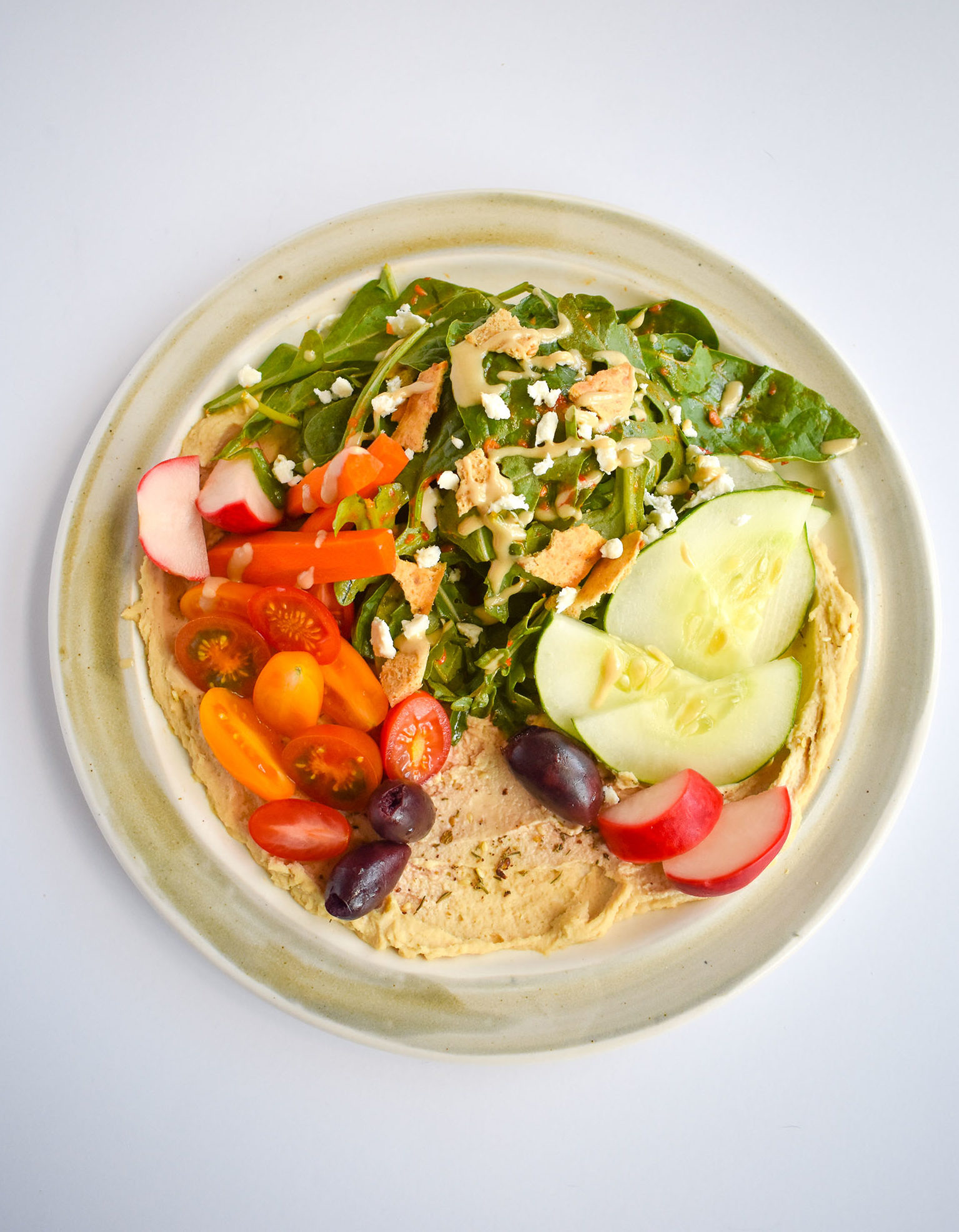 Hummus for Dinner- Hummus and vegetables on a plate.