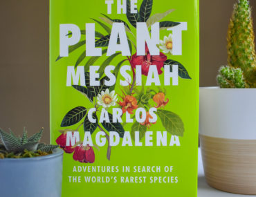 Plant Messiah book and cactus'