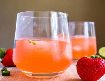 Strawberry lime gin cocktail with fruit