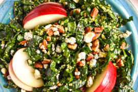 Kale quinoa apple salad in bowl