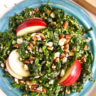 Kale quinoa apple salad in bowl
