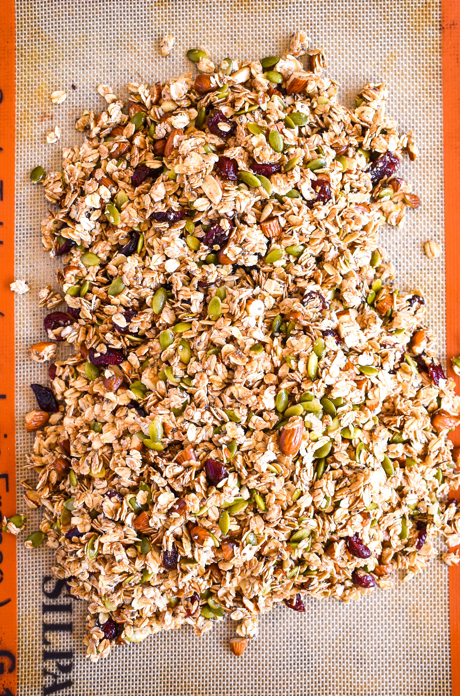 crunchy honey almond granola before baking on pan